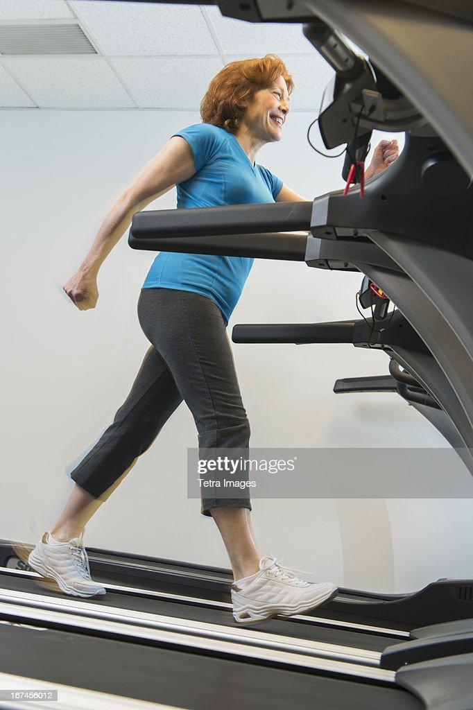 USA, New Jersey, Jersey City, Senior woman on treadmill : Stock Photo