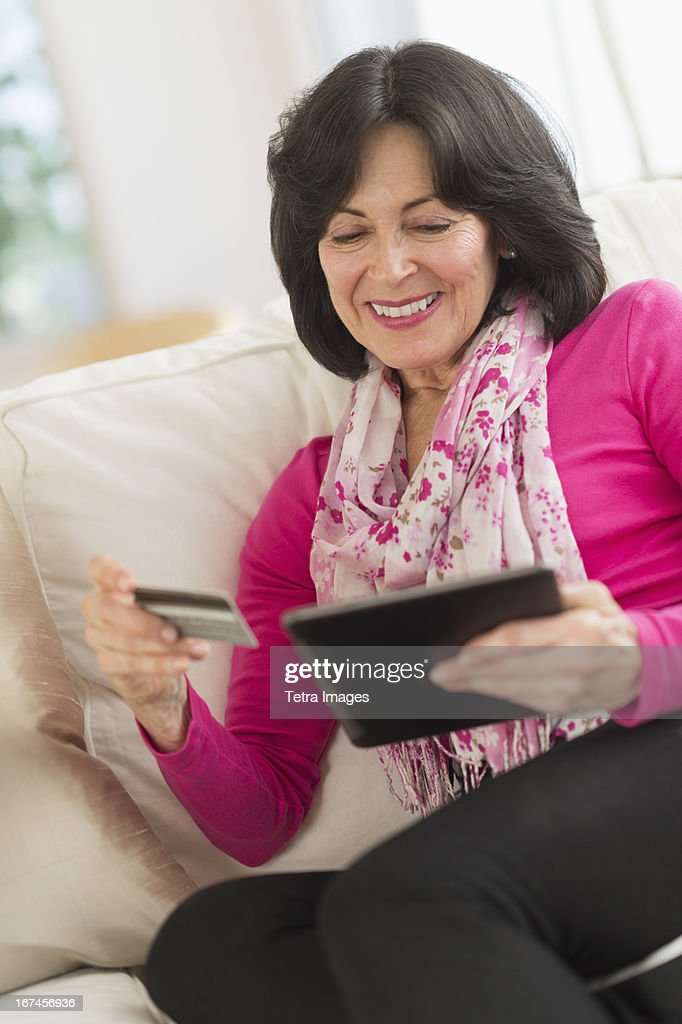 USA, New Jersey, Jersey City, Senior woman with digital tablet and credit card : Stock Photo