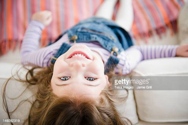 usa, new jersey, jersey city, small girl (4-5 years) lying on sofa - 4 5 years stock pictures, royalty-free photos & images