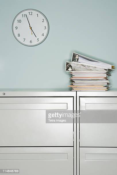 USA, New Jersey, Jersey City, Stack of documents on filing cabinet