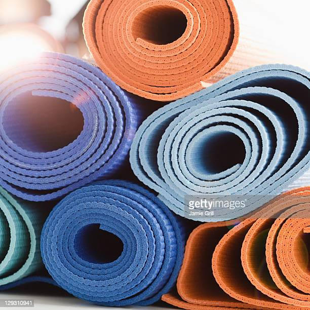 usa, new jersey, jersey city, stack of exercise mats - mat stock pictures, royalty-free photos & images