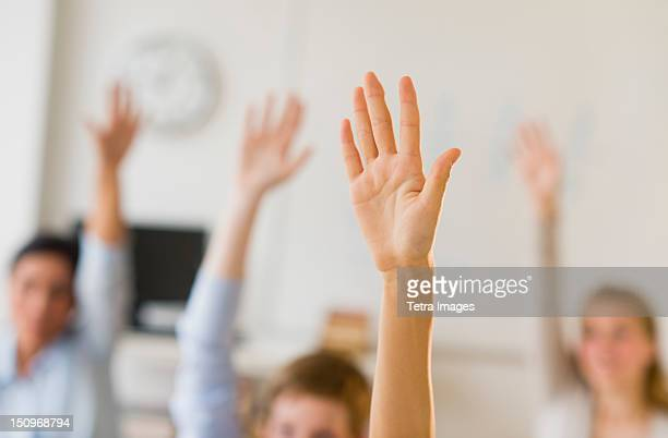 USA, New Jersey, Jersey City, Students (14-19) raising hands
