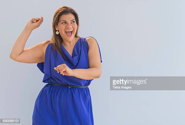 USA, New Jersey, Jersey City, Studio shot of happy woman