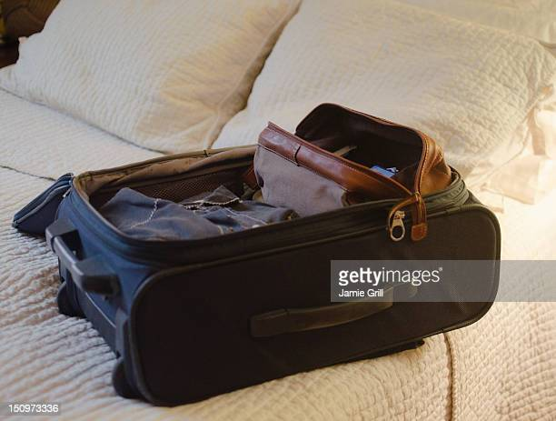 USA, New Jersey, Jersey City, Suitcase on bed