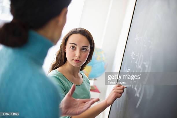 USA, New Jersey, Jersey City, Teacher talking to teenage girl (14-15)