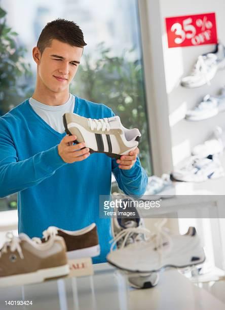 USA, New Jersey, Jersey City, teenage boy (16-17) buying shoes