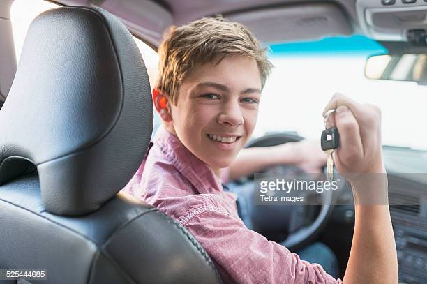 USA, New Jersey, Jersey City, Teenage boy (16-17) driving his first car