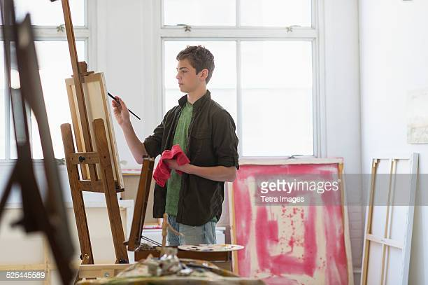 usa, new jersey, jersey city, teenage boy (16-17) painting picture - easel stock pictures, royalty-free photos & images