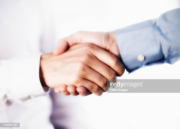 USA, New Jersey, Jersey City, Two businessman shaking hands