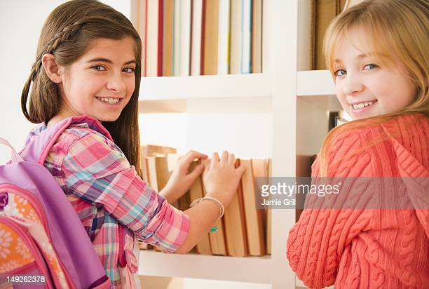 USA, New Jersey, Jersey City, Two girls in library