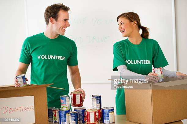 USA, New Jersey, Jersey City, Two young people as volunteers