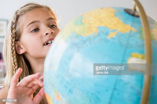 USA, New Jersey, Jersey City, View of girl (8-9) with globe