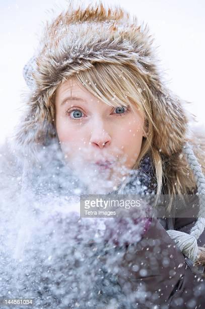 USA, New Jersey, Jersey City, Woman blowing snow