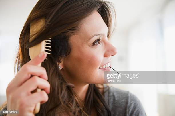 usa, new jersey, jersey city, woman brushing hair - hairpin stock pictures, royalty-free photos & images