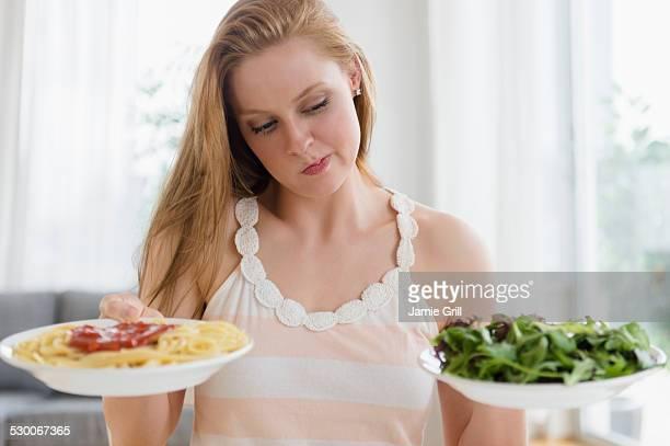 USA, New Jersey, Jersey City, Woman choosing between pasta and salad
