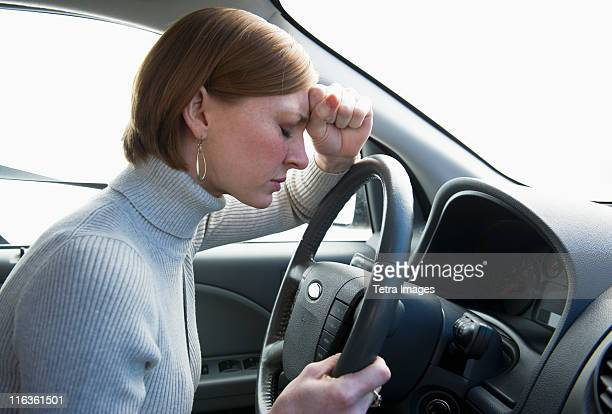 USA, New Jersey, Jersey City, woman driving car looking upset