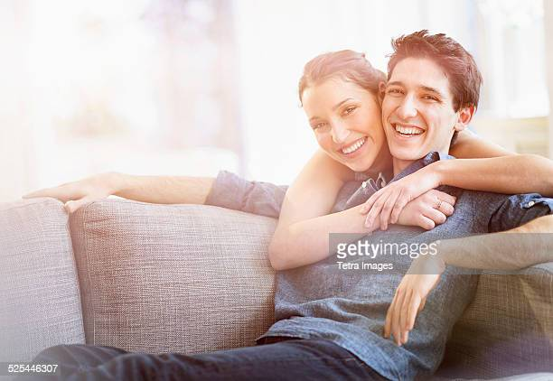 USA, New Jersey, Jersey City, Woman embracing man at home