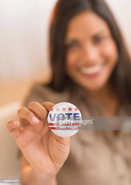 usa, new jersey, jersey city, woman holding vote button - election day stock photos and pictures