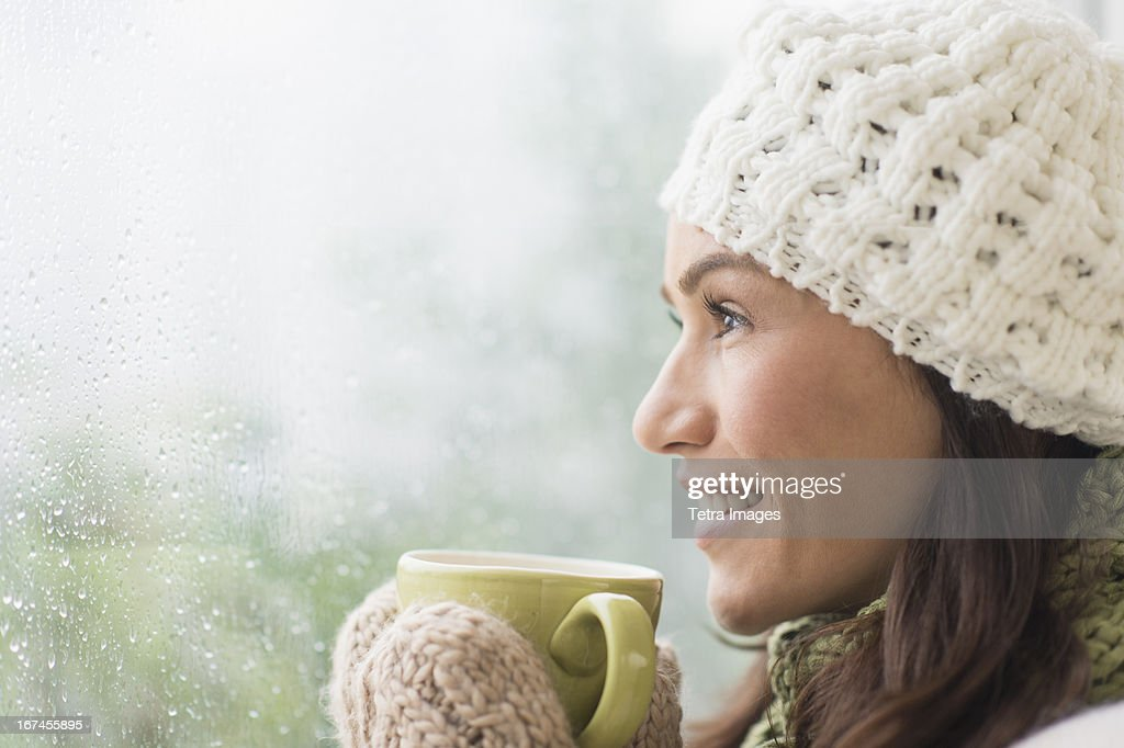 USA, New Jersey, Jersey City, Woman in warm clothes holding mug : Stock Photo