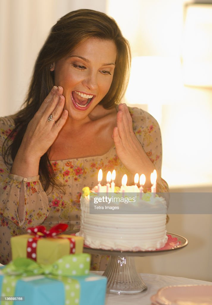 USA New Jersey City Woman Looking At Birthday Cake Stock Photo