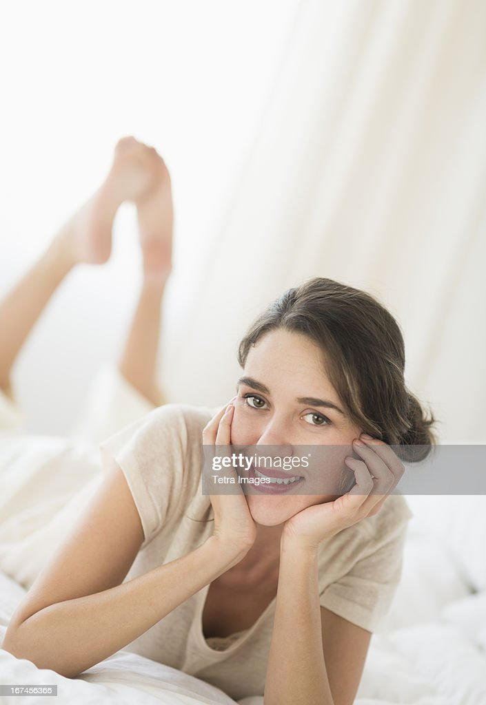 USA, New Jersey, Jersey City, Woman lying in bed  : Stock Photo
