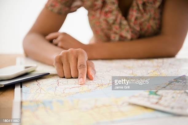 USA, New Jersey, Jersey City, Woman planning trip
