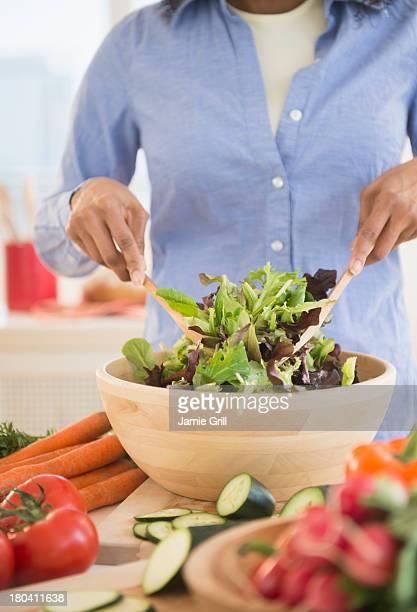 USA, New Jersey, Jersey City, Woman preparing salad