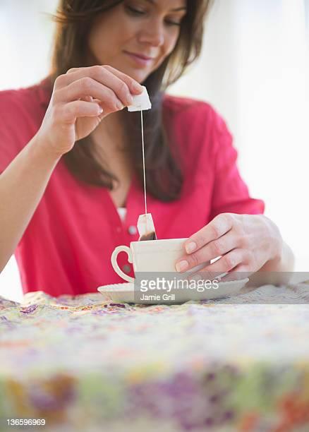 USA, New Jersey, Jersey City, Woman preparing tea