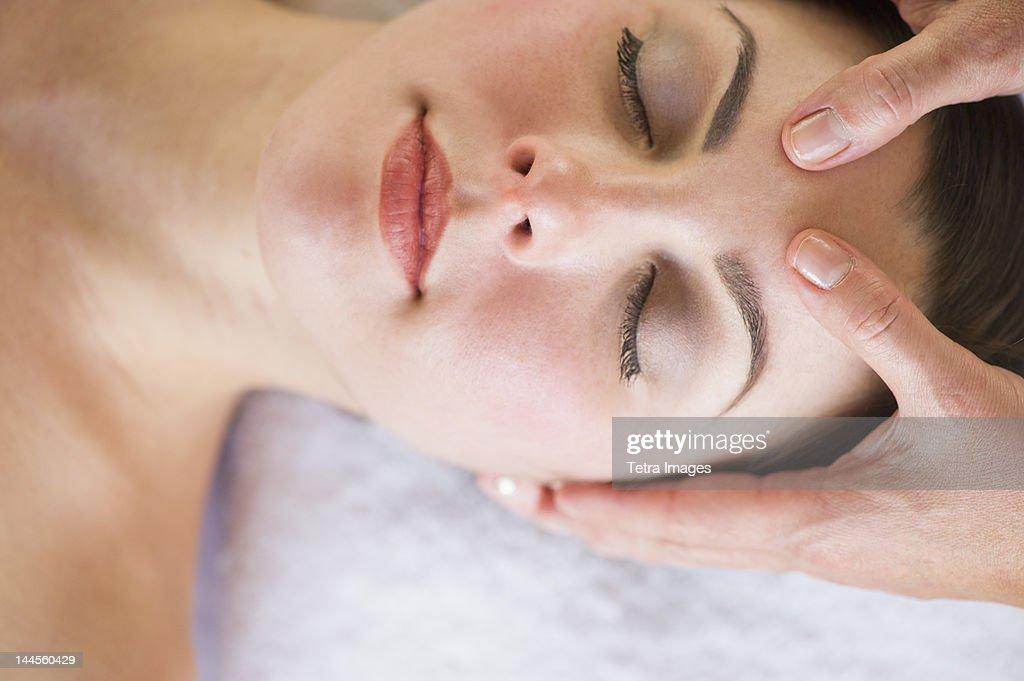 usa new jersey jersey city woman receiving face massage stock photo