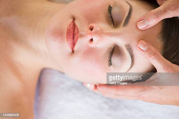 USA, New Jersey, Jersey City, Woman receiving face massage