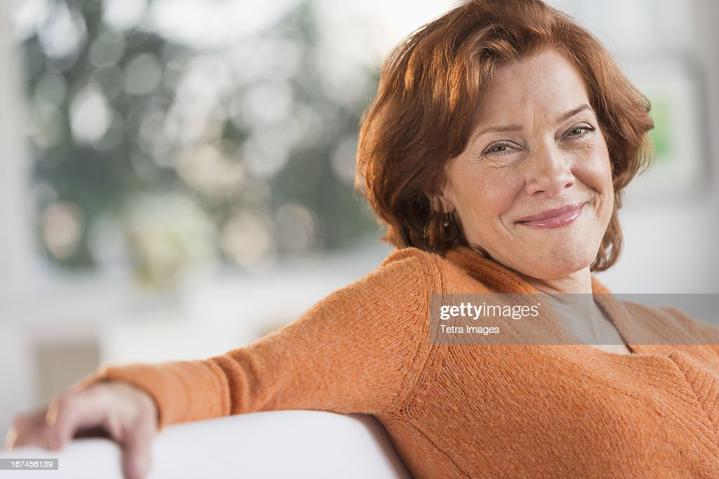 USA, New Jersey, Jersey City, Woman relaxing at home : Stock Photo