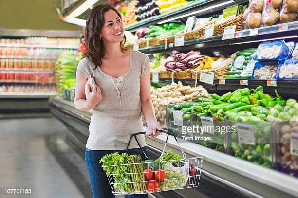 USA, New Jersey, Jersey City, Woman shopping for groceries