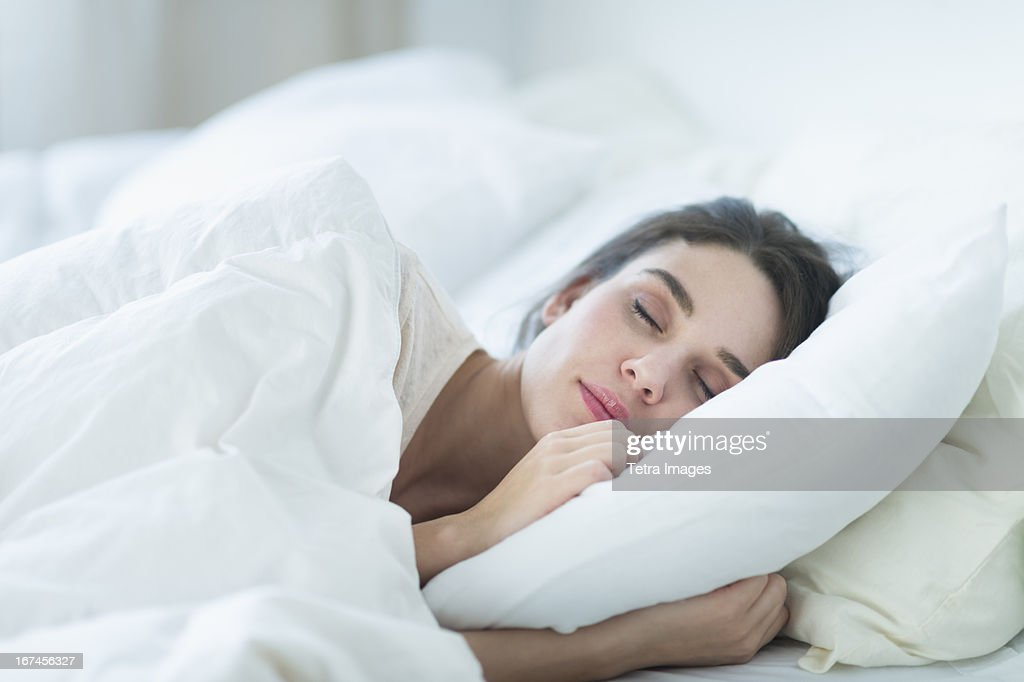 USA, New Jersey, Jersey City, Woman sleeping in bed : Stock Photo