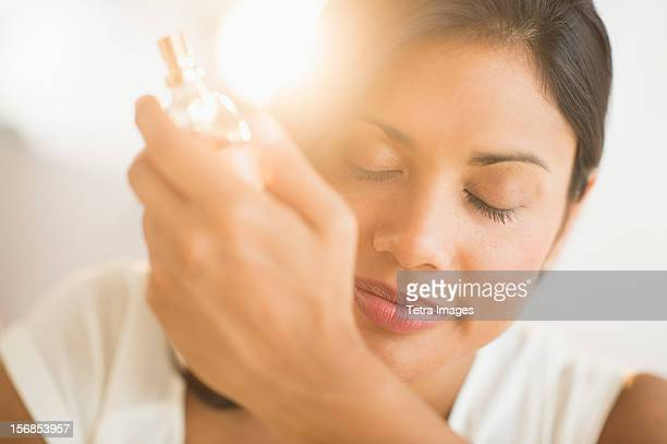 USA, New Jersey, Jersey City, Woman smelling perfume on wrist