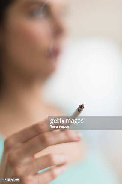 USA, New Jersey, Jersey City, Woman smoking cigarette