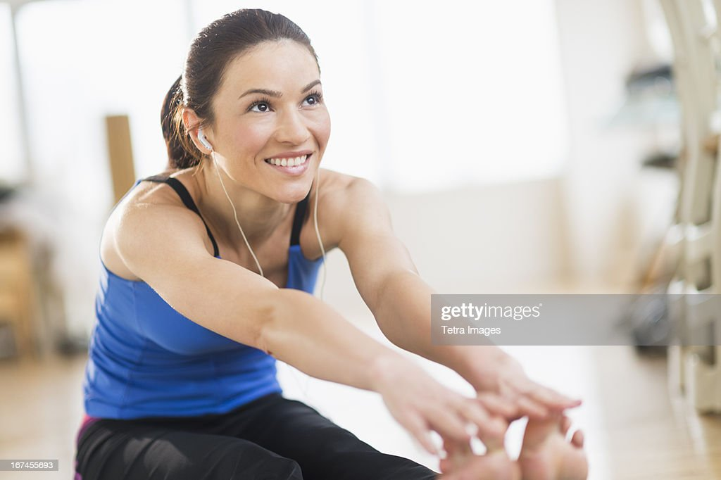 USA, New Jersey, Jersey City, Woman stretching : Stock Photo