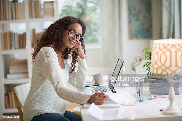 usa, new jersey, jersey city, woman using laptop in home office - adults only stock pictures, royalty-free photos & images
