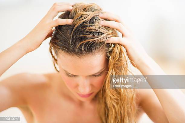 USA, New Jersey, Jersey City, Woman washing hair