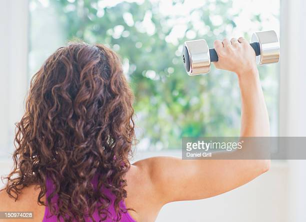 USA, New Jersey, Jersey City, Woman weight lifting