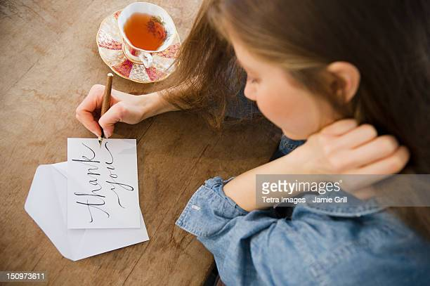 usa, new jersey, jersey city, woman writing greeting card - handwriting stock pictures, royalty-free photos & images