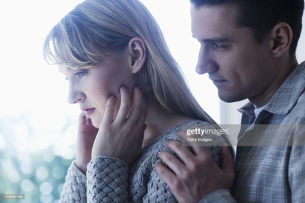 USA, New Jersey, Jersey City, Worried couple : Stock Photo