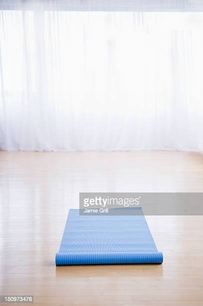 USA, New Jersey, Jersey City, Yoga mat in empty studio