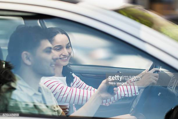 USA, New Jersey, Jersey City, Young couple traveling in car