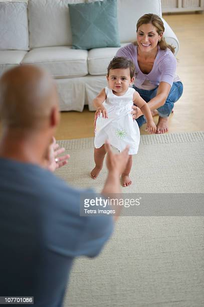 USA, New Jersey, Jersey City, Young family with small girl (12-18 months)