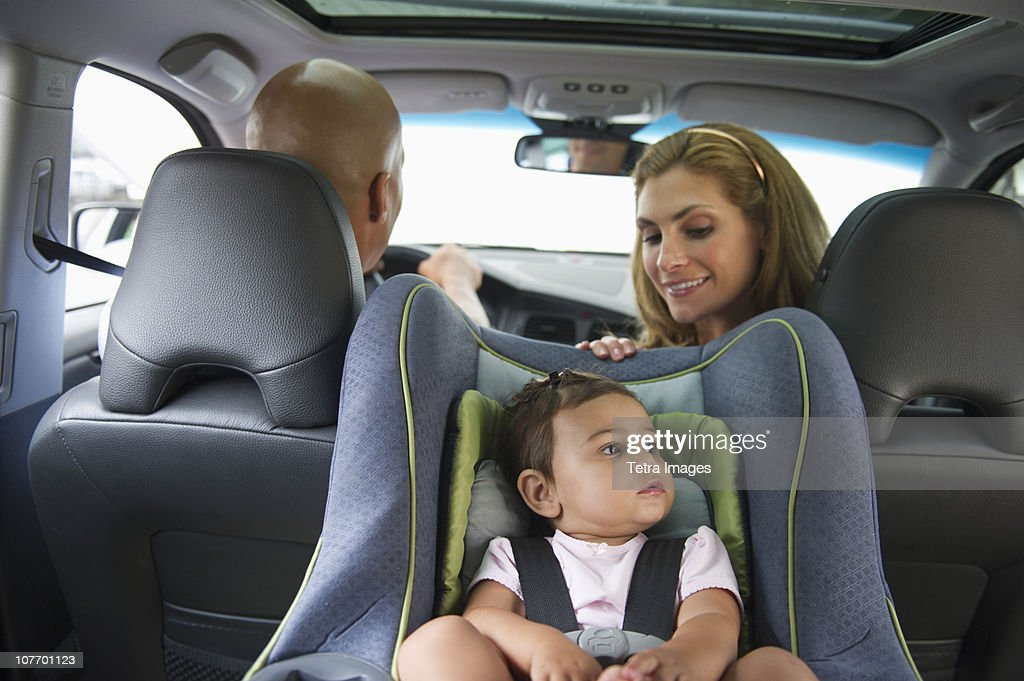 USA, New Jersey, Jersey City, Young family with small girl (12-18 months) sitting in car : Stock Photo