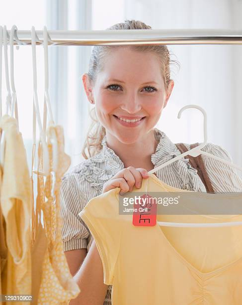 USA, New Jersey, Jersey City, Young woman in clothes shop