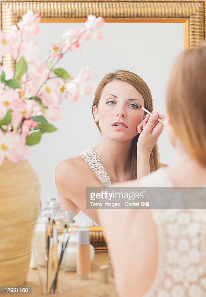USA, New Jersey, Jersey City, Young woman in front of mirror