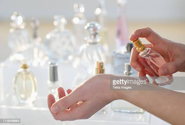 USA, New Jersey, Jersey City, Young woman testing perfume