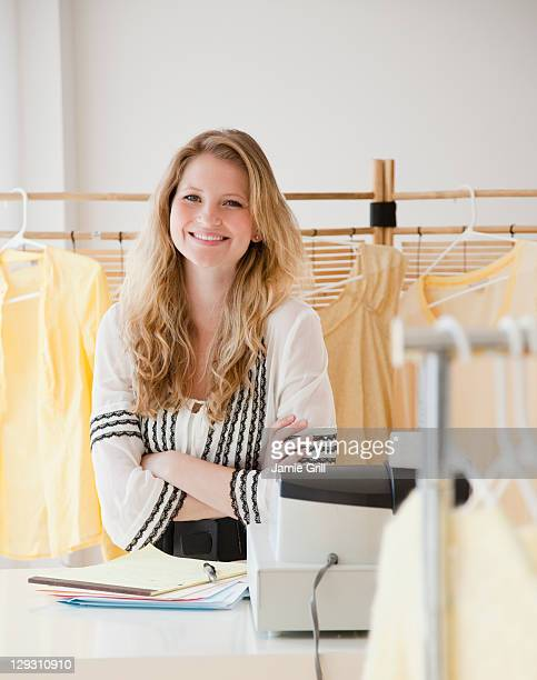 USA, New Jersey, Jersey City, Young woman working in clothes shop
