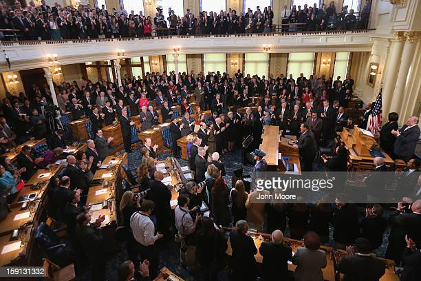 New Jersey lawmakers stand and applaud as New Jersey Governor Chris Christie makes his State of the State Address in the Assembly Chamber at the...